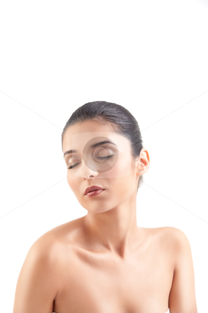 A beauty image of a young woman with her eyes shut. stock photo, a studio beauty shot of a beautiful woman, with naked shoulders, on white background. her head is turned to the side and her eyes are shut. by dan comaniciu