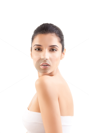 A beauty image of a young woman looking over her shoulder. stock photo, a studio beauty shot of a beautiful woman, with naked shoulders, on white background. she looks straight into the camera over her shoulder and her mouth is slightly open. by dan comaniciu