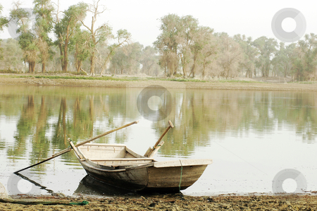 Boat at lake stock photo, Scenery of a wooden boat at a lake by John Young