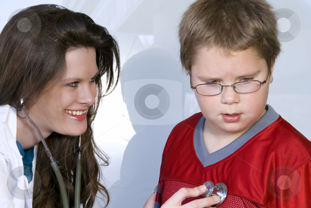 Female Pediatrician stock photo, A Female Pediatrician examining a young boy by Robert Byron