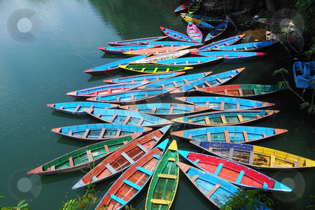 Colorful tour boats stock photo, Scenery of colorful tour boats at a lake by John Young