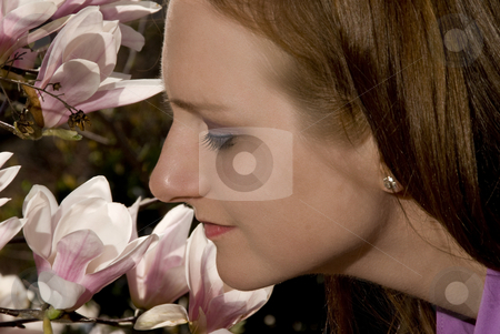 Stop and Smell the Flowers stock photo, A woman who has stopped to smell the flowers by Robert Byron