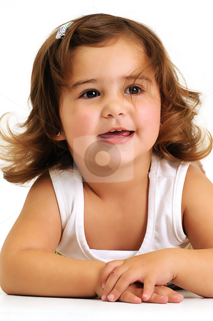 Little beautiful girl looking and smiling whilst leaning on her arms stock photo, Little beautiful girl looking and smiling whilst leaning on her arms by Ansunette