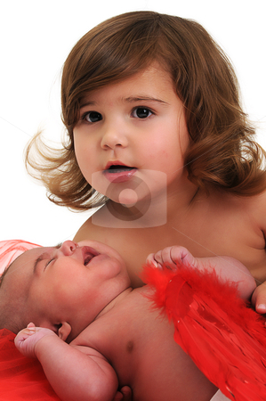 Two sisters playing and smiling in studio wearing red angle wings stock photo, two sisters playing and smiling in studio wearing red angle wings by Ansunette