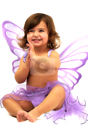 Little girl with purple angle wings sitting and smiling stock photo, little girl with purple angle wings sitting in studio and smiling by Ansunette