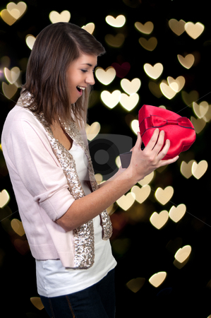 Valentines Day Heart Box Gift Woman stock photo, A beautiful young woman holding a Valentines Day heart box gift present by Robert Byron