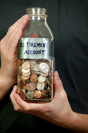 Retirement Account stock photo, A young man holding a jar of money coins labeled retirement acount by Robert Byron