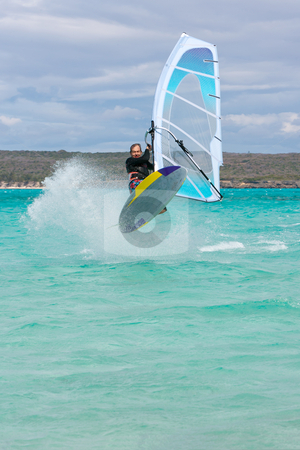 Windsurf stock photo, Windsurfer jumping a wave in the lagoon, Babaomby, Madagascar by Pierre-Yves Babelon