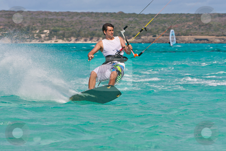 Kitesurf in the lagoon stock photo, Male kitesurfer enjoying his sport in the lagoon of Babaomby, Madagascar by Pierre-Yves Babelon
