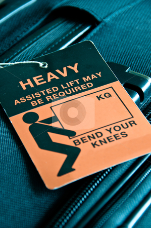 Heavy Luggage stock photo, Luggage - black trolley -  tagged with HEAVY sign by Frank G?