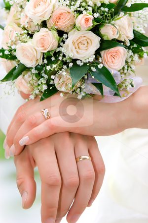 Hands of new married stock photo, hands of new married with golden rings and bouquet by Olga Sapegina