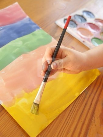 Painting  stock photo, a child painting with water colors  by Lars Kastilan