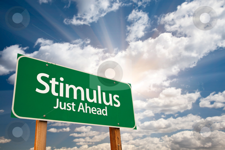 Stimulus Green Road Sign and Clouds stock photo, Stimulus Green Road Sign with Dramatic Clouds, Sun Rays and Sky. by Andy Dean