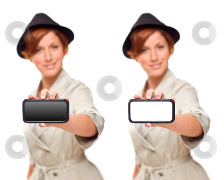 Smiling Young Woman Holding Blank White and Black Smart Phone stock photo, Smiling Young Woman Holding Blank White and Black Smart Phone Isolated on White. by Andy Dean