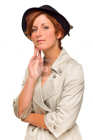 Attractive Red Haired Girl Wearing a Trenchcoat and Hat stock photo, Attractive Red Haired Girl Wearing a Trenchcoat and Hat Isolated on a White Background. by Andy Dean