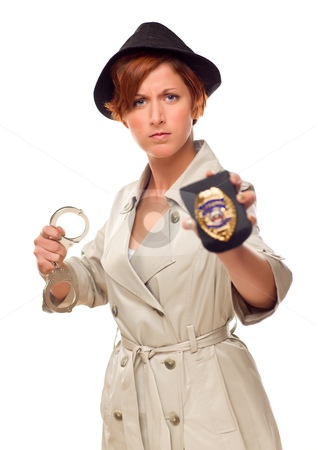 Red Haired Female Detective With Handcuffs and Badge In Trenchco stock photo, Red Haired Female Detective With Handcuffs and Badge In Trenchcoat Isolated on a White Background. by Andy Dean