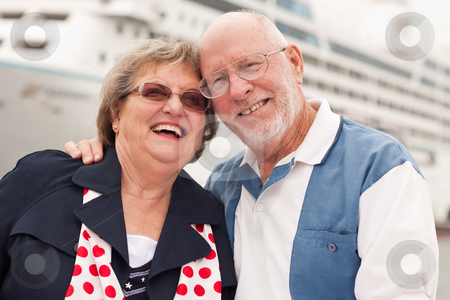 Senior Couple On Shore in Front of Cruise Ship stock photo, Senior Couple On Shore in Front of Cruise Ship While on Vacation. by Andy Dean