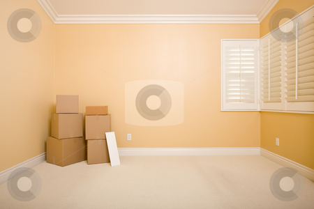 Moving Boxes and Blank Sign in Empty Room stock photo, Moving Boxes and Blank Sign on Floor in Empty Room with Copy Space on Blank Wall. by Andy Dean