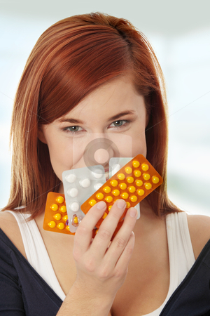 Young woman with pills stock photo, Young woman with pills  by Piotr_Marcinski