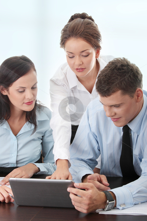 Business taam stock photo, Interracial business team working at laptop in a office by Piotr_Marcinski
