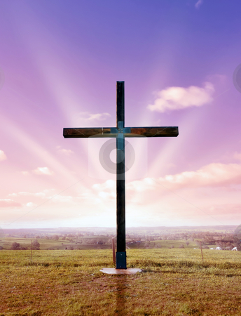Christian cross at sunset or sunrise stock photo, christian cross of christ at sunset or sunrise by Phil Morley