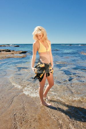 Young woman on reef at sea stock photo, beautiful young woman on the reef rocks at the sea by Phil Morley
