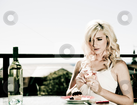 Beautiful woman in restaurant  stock photo, beautiful woman sits at restaurant table with wine by herself by Phil Morley