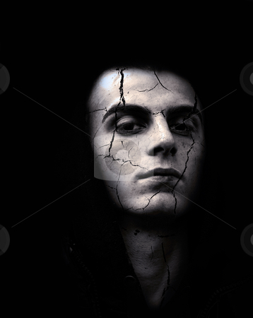Young man with cracked skin stock photo, portrait of spooky looking man with cracked skin by borojoint