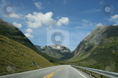 Norwegian mountains stock photo, a road throw the beautiful norwegian mountains by Stelian Ion