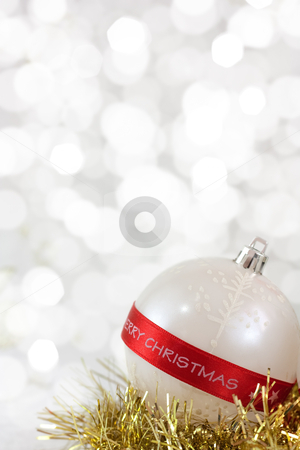 Merry Christmas Bauble stock photo, White Christmas bauble with Merry Christmas sign and light reflections on background of defocused  lights  . Shallow DOF.   by borojoint