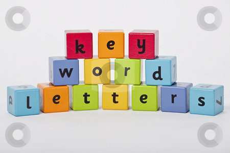 Letters are the key to the world of knowledge stock photo, wooden blocks with letters stacked up on white background by photomim