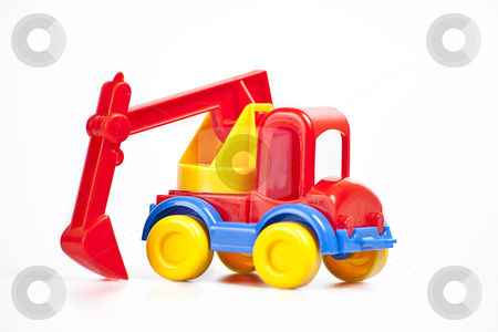 Digger stock photo, colorful digger toy on the white background by photomim
