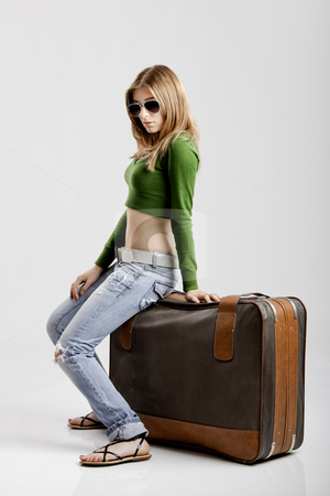 Travel Woman stock photo, Beautiful young woman with old leather suitcases by ikostudio