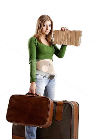 Hitch hiking woman stock photo, Beautiful young woman hitch hiking with card tablet by ikostudio