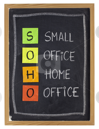 Home or virtual office concept stock photo, virtual office concept - SOHO acronym (small office, home office) - white chalk handwriting and sticky notes on blackboard, isolated on white by Marek Uliasz