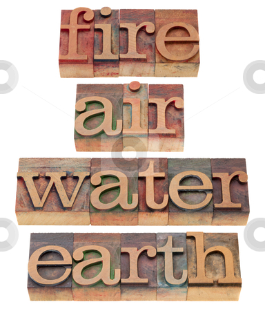 Fire, air, water and earth stock photo, four classical elements of Greek philosophy - fire, air, water and earth - words in vintage wooden letterpress printing blocks, isolated on white by Marek Uliasz
