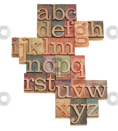 Alphabet abstract in wooden fonts stock photo, alphabet - abstract of vintage wooden letterpress printing blocks stained by color inks, isolated on white by Marek Uliasz