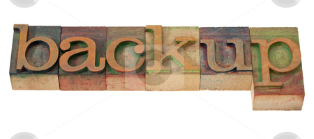 Backup - word in letterpress type stock photo, backup - word in vintage wooden letterpress printing blocks, stained with color inks, isolated on white by Marek Uliasz