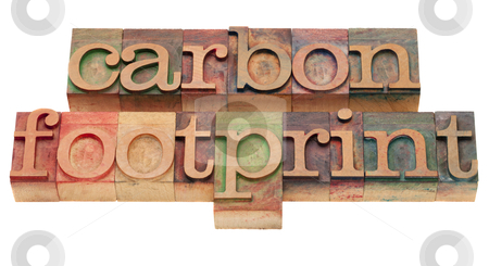 Carbon footrpint - word sin letterpress type stock photo, carbon footprint - word sin vintage wooden letterpress printing blocks, stained by color inks, isolated on white by Marek Uliasz