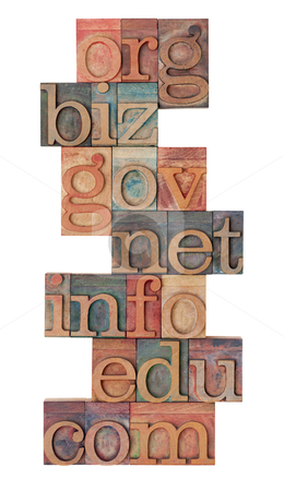 Internet domains in letterpress type stock photo, collage of popular internet domain extensions (org, biz, gov, net, info, edu, com) - vinatage wooden letterpress printing blocks, stained by color inks, isolated on white by Marek Uliasz
