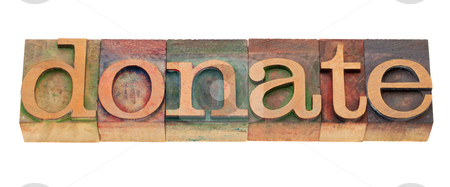 Donate - word in letterpess type stock photo, donate - word in vintage wooden letterpress printing blocks, stained by color inks, isolated on white by Marek Uliasz