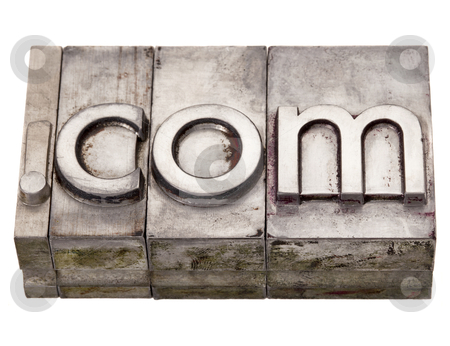 Dot com - internet domain in letterpress type stock photo, dot com internet domain extension in vintage grunge metal letterpress printing blocks, stained by color inks, isolated on white by Marek Uliasz
