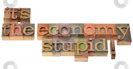 The economy stupid - phrase in letterpress type stock photo, It's the economy stupid, a slogan from Bill Clinton presidential campaign  in vintage wooden letterpress printing blocks, stained by color inks, isolated on white by Marek Uliasz