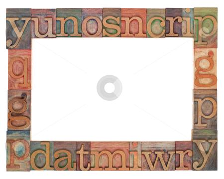 Alphabet frame in letterpress type stock photo, horizontal alphabet frame - random vintage wood letterpress printing blocks surrounding white copy space by Marek Uliasz