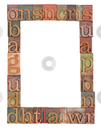 Alphabet frame in letterpress type stock photo, vertical alphabet frame - random vintage wood letterpress printing blocks surrounding white copy space by Marek Uliasz