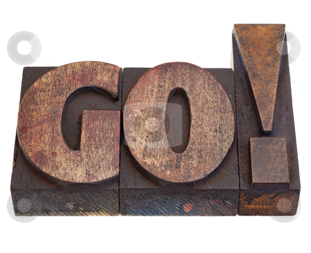 Go - word in letterpress type stock photo, GO - exclamation, start or call for action in vintage wood letterpress printing blocks, isolated on white by Marek Uliasz