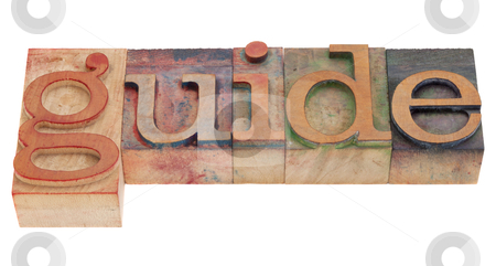 Guide word in letterpress type stock photo, guide word in vintage wood letterpress printing blocks, stained by color inks, isolated on white by Marek Uliasz