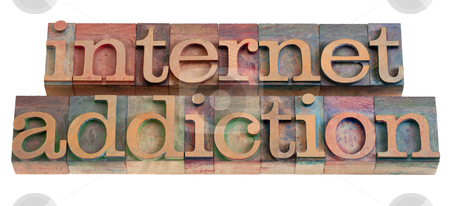 Internet addiction stock photo, internet addiction phrase in vintage wooden letterpress printing blocks, stained by color inks, isolated on white by Marek Uliasz