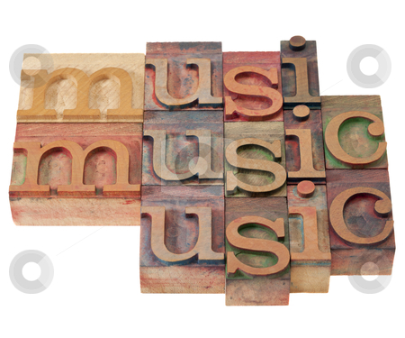 Music - word abstract in letterpress type stock photo, music  - isolated word abstract in vintage wood letterpress printing blocks stained by color inks by Marek Uliasz