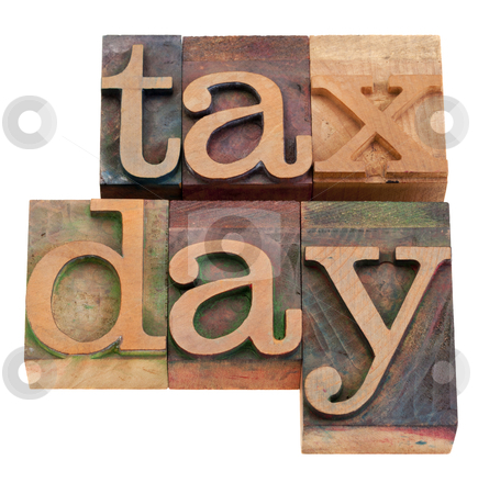 Tax day iwords in letterpress type stock photo, tax day - words in vintage wooden letterpress printing blocks, stained by color inks, isolated on white by Marek Uliasz